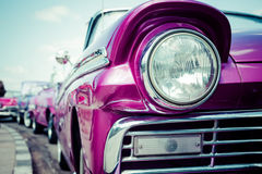 Concept of Cuba attractions. Headlight of old car in Havana, Cub. A. Shallow DOF. Toned, horizontal Stock Photo