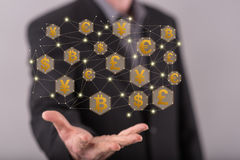 Concept of currency exchange. Currency exchange concept above the hand of a man in background Royalty Free Stock Image