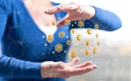 Concept of currency exchange. Currency exchange concept between hands of a woman in background stock image