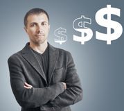 Concept currency growth. Young businessman is standing on a growth chart currency Royalty Free Stock Photos