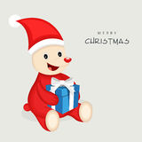Concept of cute animal in Santa dress with gift box. Royalty Free Stock Image