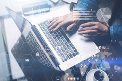 Concept of cyber security.Man working at sunny office on laptop while sitting at the wooden table.Background of digital Royalty Free Stock Image
