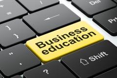 Concept d'éducation : Éducation d'affaires sur le fond de clavier d'ordinateur Image stock