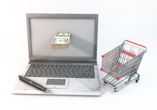 Concept 3d abstract Shopping cart with 100 dollar bill in Comput. 3D Graphic computer and 100 dollar bills protrude with near shopping cart. Rendered at high Stock Image