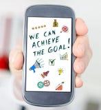 Concept d'accomplissement de but sur un smartphone photo libre de droits