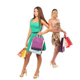 Concept d'achats et de tourisme - belles filles avec des sacs Photos stock