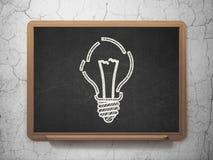 Concept d'affaires : Ampoule sur le fond de tableau Photographie stock libre de droits