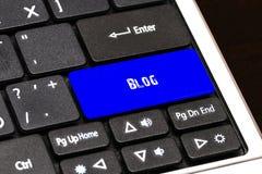 Concept d'affaires - bouton bleu de blog sur mince Photographie stock libre de droits