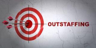 Concept d'affaires : cible et Outstaffing sur le fond de mur Photographie stock libre de droits