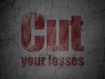 Concept d'affaires : Coupez vos pertes sur le fond grunge de mur Photo libre de droits