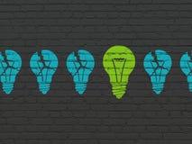 Concept d'affaires : icône d'ampoule sur le mur Photographie stock