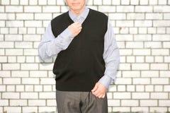 Concept d'affaires L'homme dans le noir Contre une brique Photographie stock libre de droits