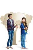 Concept d'amour Couples des enfants le garçon donne un isolat de fleurs de carton de fille sur le blanc Images libres de droits