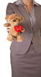 Concept d'amour d'ours de nounours de fixation de femme d'affaires Photos stock