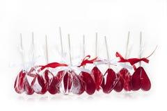 Concept d'amour Lucettes rouges de coeurs Images stock