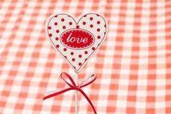 Concept d'amour Plat dans la forme du coeur, plan rapproché Photographie stock