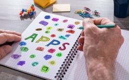 Concept d'Apps sur un bloc-notes Photographie stock