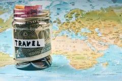 Concept d'argent de l'épargne de voyage Photo stock