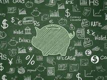 Concept d'argent : Tirelire sur le fond de conseil pédagogique Photographie stock