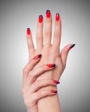 Concept d'art de clou avec des mains sur le blanc Photographie stock libre de droits