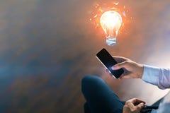 Concept d'idée avec l'homme d'affaires et l'ampoule Photographie stock