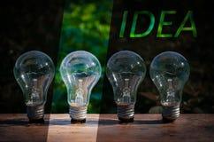 Concept d'idée d'ampoule un nombre Photographie stock libre de droits