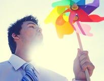 Concept d'énergie de puissance de Blowing Wind Summer d'homme d'affaires Photos libres de droits