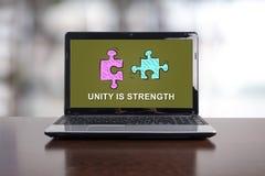 Concept d'unité sur un ordinateur portable Photographie stock libre de droits