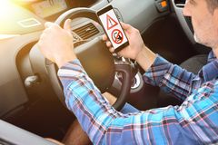 Concept of the danger of the use of mobile driving royalty free stock photo