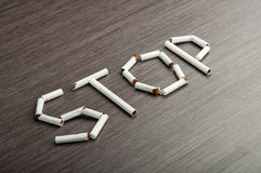 Concept of dangers of smoking. word Stock Images