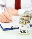 Concept dat de bedrijfsmens financieel plan maakt Royalty-vrije Stock Afbeeldingen