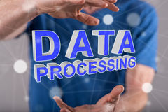 Concept of data processing. Data processing concept between hands of a man in background Royalty Free Stock Photos