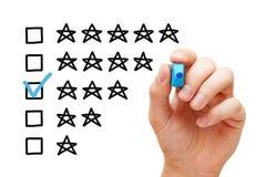 Concept de évaluation moyen de trois étoiles photo libre de droits