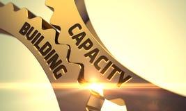 Concept de bâtiment de capacité Roues dentées d'or 3d Image libre de droits