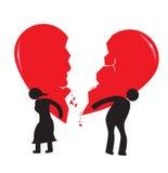 Concept de chagrin d'amour de divorce Le coeur brisé porté par l'homme et la femme de bâton Photo stock