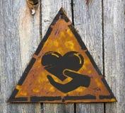 Concept de charité sur le panneau d'avertissement superficiel par les agents. Photo stock