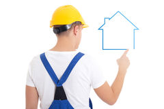 Concept de construction - homme dans l'isolant uniforme de maison de dessin de constructeur Photos stock