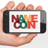 Concept de Cryptocurrency : Main tenant Smartphone avec Namecoin sur l'affichage Photographie stock libre de droits