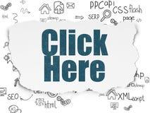 Concept de développement de Web : Cliquez ici sur le papier déchiré Images stock