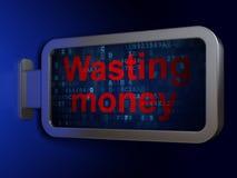 Concept de devise : Gaspillage de l'argent sur le fond de panneau d'affichage Photos libres de droits