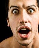 Concept de défaut de la reproduction sonore - homme stupéfait avec de grands yeux Image libre de droits