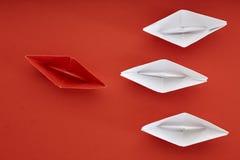 Concept de direction avec le bateau de papier rouge Images stock