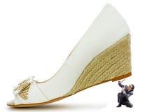 Concept de domination de femme - chaussures et homme Image stock