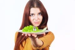 Concept de fille et de nourriture lourde Photo libre de droits