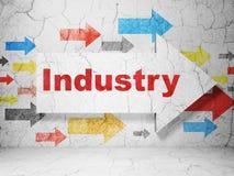 Concept de finances : flèche avec l'industrie sur le fond grunge de mur Photographie stock libre de droits