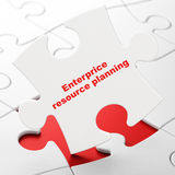 Concept de finances : Planification de ressource d'Enterprice sur le fond de puzzle Image stock