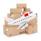 Concept de fret aérien Bande dessinée Toy Jet Airplane avec le drapeau de la Chine près Image stock