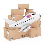 Concept de fret aérien Bande dessinée Toy Jet Airplane avec le drapeau des Etats-Unis près de B Image libre de droits