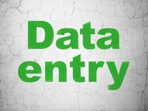 Concept de l'information : Saisie de données sur le fond de mur photos stock
