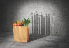 Concept de la consommation saine Vitamines Emballez complètement de l'ombre de fonte de produits sous la forme de vitamines graph Images libres de droits